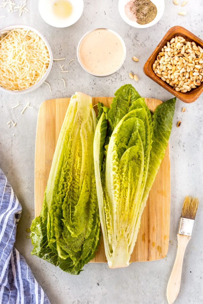 Overhead shot of ingredients needed for grilled caesar salad