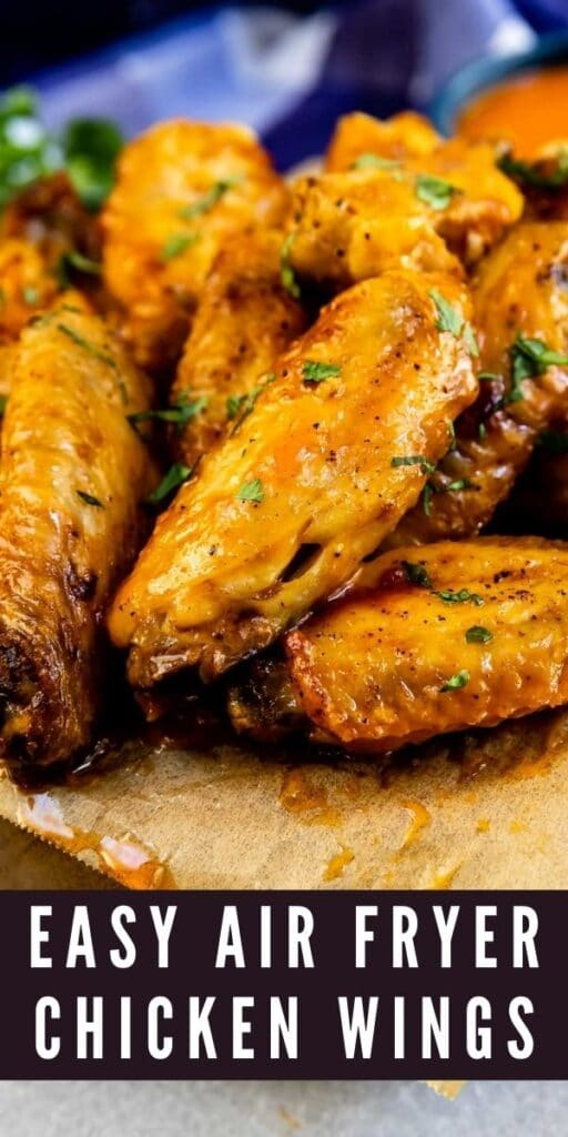 Close up shot of easy air fryer chicken wings with recipe title on bottom of photo