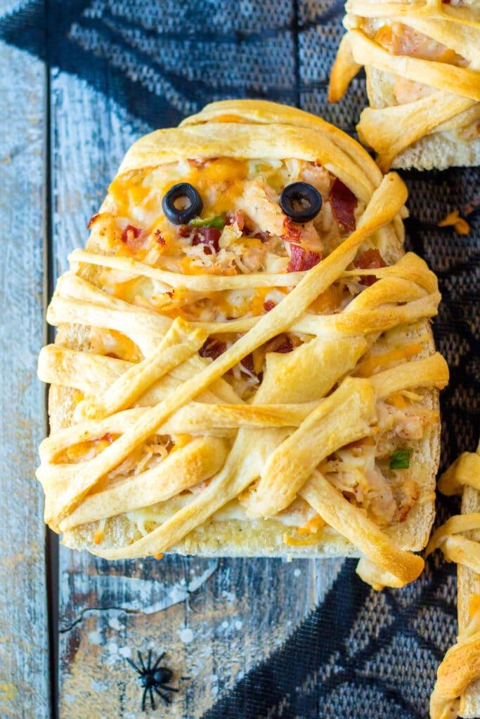 Overhead shot of chicken bacon ranch mummy pizza