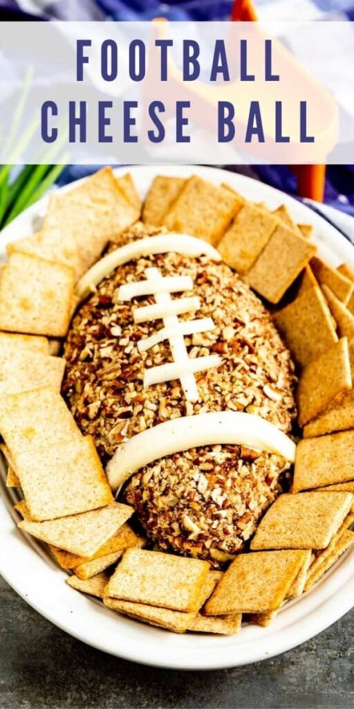 Overhead shot of Football Cheese Ball on a serving plate surrounded by crackers with recipe title on top of image