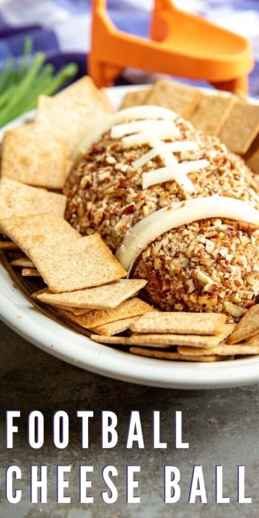 Football Cheese Ball on a serving plate surrounded by crackers with recipe title on bottom of photo
