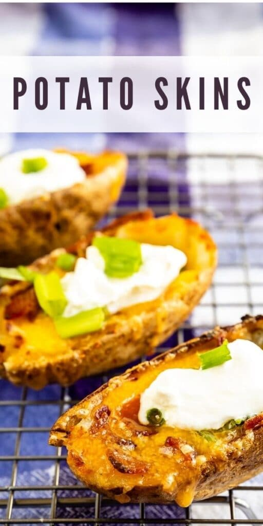Three potato skins on a metal cooking rack topped with sour cream and recipe title on top of image