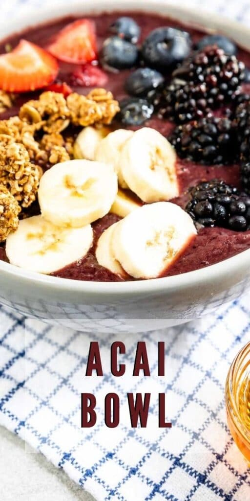 Close up overhead shot of an acai bowl with recipe title on bottom of photo