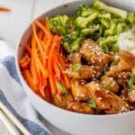 Close up shot of easy teriyaki chicken bowl with recipe title on bottom of photo