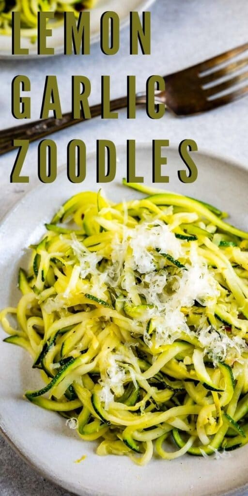Close up overhead shot of lemon garlic zoodles with recipe title on top of photo