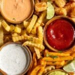 Overhead shot of french fry charcuterie board with recipe title on top of image